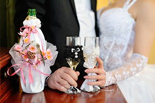 Couple touches glasses at unique wedding venues Toronto